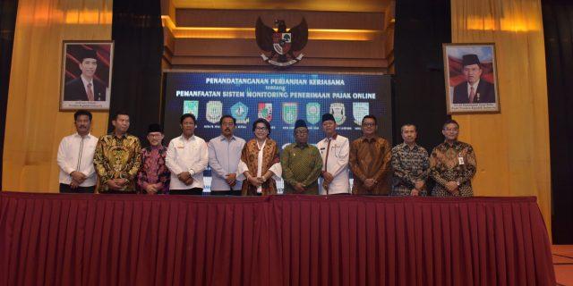 Bank Riau Kepri dan Empat BPD Lainnya Teken MoU Dengan 16 Bupati/Walikota Dihadapan KPK RI Tentang Pajak Online